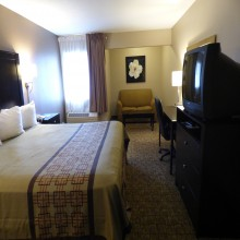 King Bedroom at Ramada by Wyndham Fresno