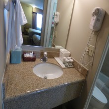 Ramada by Wyndham Fresno King Bedroom Bathroom